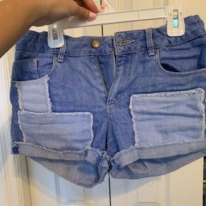 blue patched shorts